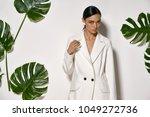 fancy girl is posing in a... | Shutterstock . vector #1049272736