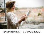 happy female tourist... | Shutterstock . vector #1049275229