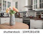 bouquet of tulips in interior... | Shutterstock . vector #1049281658