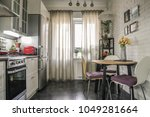 interior of the kitchen in... | Shutterstock . vector #1049281664