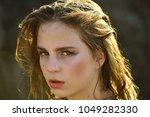 woman with long wet hair ...   Shutterstock . vector #1049282330