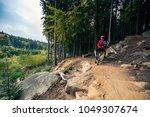 mountain biker riding on bike... | Shutterstock . vector #1049307674