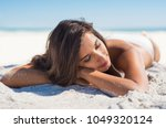 relaxed woman lying down on...   Shutterstock . vector #1049320124