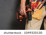 close up of handyman holding a... | Shutterstock . vector #1049320130