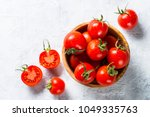 tomatoes on gray stone table. | Shutterstock . vector #1049335763