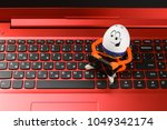 funny easter egg working on a... | Shutterstock . vector #1049342174