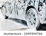 washing  black car with active ... | Shutterstock . vector #1049344766
