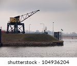 Vintage wooden harbor crane in the city of Nijmegen - stock photo