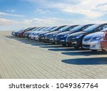 cars for sale stock lot row.... | Shutterstock . vector #1049367764