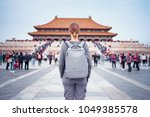 enjoying vacation in china.... | Shutterstock . vector #1049385578