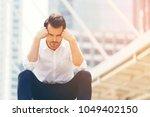 caucasian businessman sitting... | Shutterstock . vector #1049402150