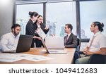young trainee business people... | Shutterstock . vector #1049412683