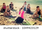 yoga on beach  group of people... | Shutterstock . vector #1049423129