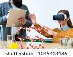 young teacher using virtual... | Shutterstock . vector #1049423486
