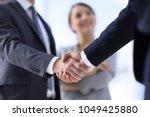 closeup of handshake of... | Shutterstock . vector #1049425880