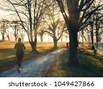 female jogger in a park during...   Shutterstock . vector #1049427866