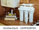 installing a water filter | Shutterstock . vector #1049428934
