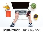 woman working on laptop with... | Shutterstock . vector #1049432729