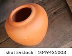 thai earthenware handmade ... | Shutterstock . vector #1049435003