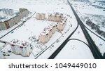 winter city from a height.... | Shutterstock . vector #1049449010
