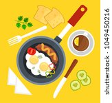 scrambled eggs fried in frying... | Shutterstock .eps vector #1049450216