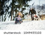 woman and little girl play on... | Shutterstock . vector #1049455103