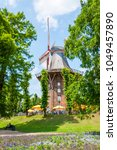 Small photo of Bremen, Germany - June 12, 2011: This mill still standing today dates back to 1898 and is an example of 'Goleriehollander' with shuttered sails and wind vane steerage on a fixed multi-cornered rump.