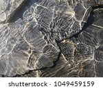 surface water  rock under the... | Shutterstock . vector #1049459159
