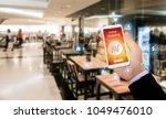 online shopping. hand holding... | Shutterstock . vector #1049476010