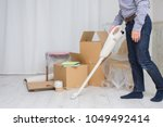 torso man cleaning up the room | Shutterstock . vector #1049492414