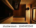 sauna  wooden interior baths ... | Shutterstock . vector #1049495549