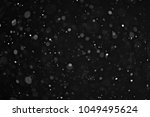 snow on a black background... | Shutterstock . vector #1049495624