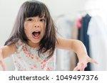 beautiful angry little girl... | Shutterstock . vector #1049497376