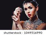 beautiful woman with dark... | Shutterstock . vector #1049516990