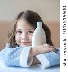 cute little girl keeping white... | Shutterstock . vector #1049519900