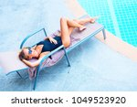 beautiful young suntanned... | Shutterstock . vector #1049523920
