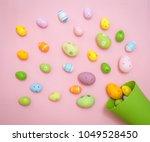 colorful easter eggs spilled... | Shutterstock . vector #1049528450