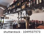 ready to pint of beer on a bar... | Shutterstock . vector #1049537573
