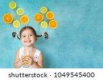 smiling girl keeps glass of... | Shutterstock . vector #1049545400
