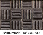 Small photo of Dark vitrified clay panels with alternating directions.