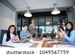 business people are discussing... | Shutterstock . vector #1049567759
