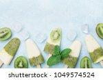 green frozen fruity popsicles... | Shutterstock . vector #1049574524