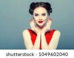 pin up woman studio portrait | Shutterstock . vector #1049602040