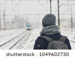 Railway In Winter. Young Man...