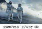 Two Astronauts Explore Rocky...
