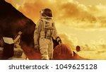 astronaut on mars walking on... | Shutterstock . vector #1049625128