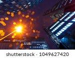 illuminated office buildings in ... | Shutterstock . vector #1049627420