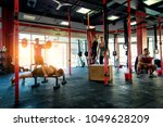 muscular athletes training in a ... | Shutterstock . vector #1049628209