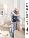 hold me close. happy elderly... | Shutterstock . vector #1049632319
