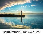 Lighthouse And Harbour Emergin...